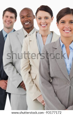 Confident smiling tradesteam standing together against a white background
