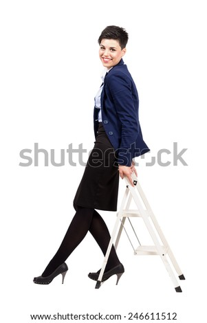 Confident smiling woman leaning on the small construction ladder. Full body length portrait isolated over white background. - stock photo