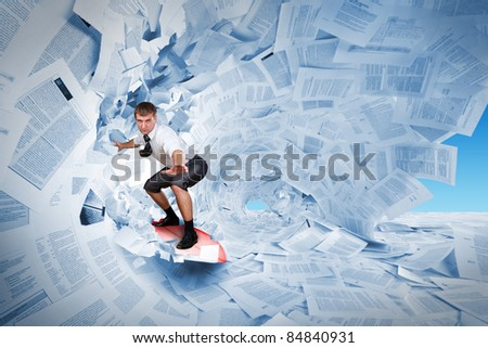 Confident surfer riding the barrel of documents wave - stock photo