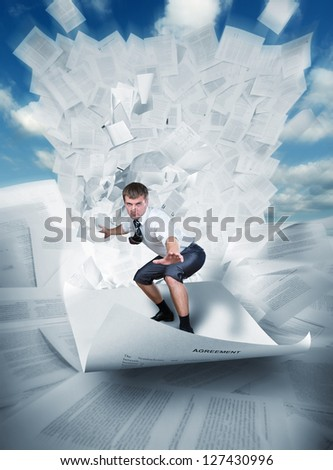 Confident surfer riding the wave of documents - stock photo