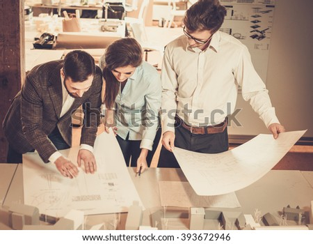 Confident team of engineers working together in a architect studio.