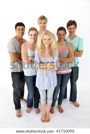 Confident teenagers standing and smiling in front of the camera - stock photo