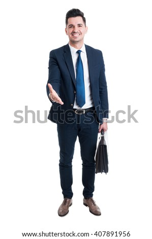Confident trustworthy and friendly sales man offer handshake standing isolated on white background - stock photo