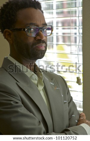 Confident well dressed businessman - stock photo