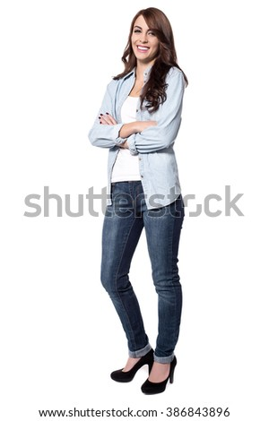 Confident woman against a white background with crossed arms - stock photo