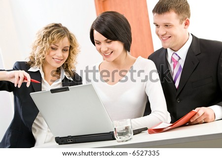 Confident woman explains correct way of analysis to her colleagues - stock photo