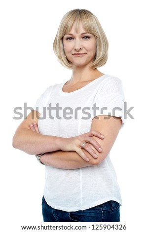 Confident woman in trendy wear with arms folded isolated against white. - stock photo