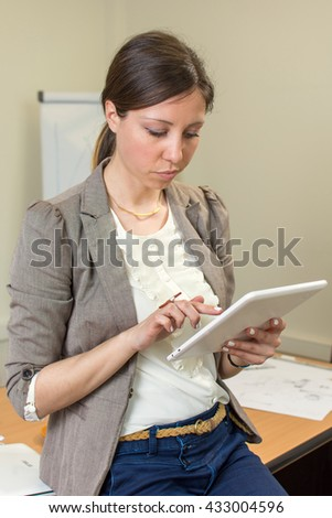Confident woman leader portrait at the office - stock photo