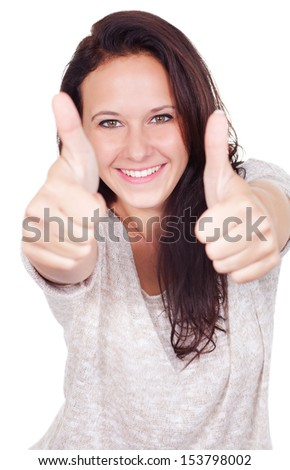 Confident woman lifts thumbs - stock photo
