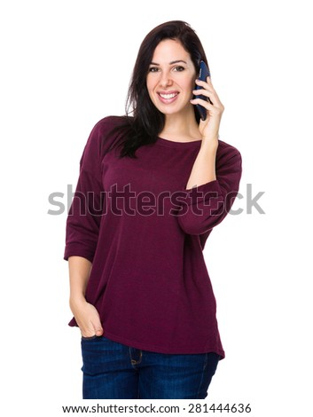 Confident woman talk to smart phone - stock photo