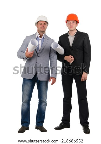 Confident young architectural team wearing hard hats and suits staning side by side looking at the camera with rolled blueprints under their arms, isolated on white - stock photo