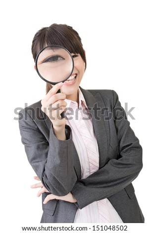 Confident young asian woman looking through a magnifying glass. Isolated on the white background. - stock photo