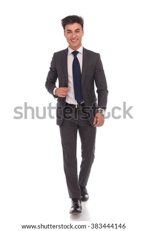 confident young business man laughing and walking forward on white background - stock photo
