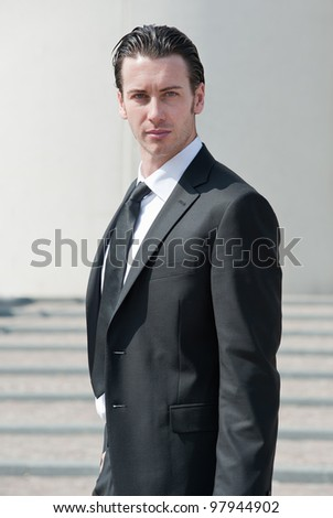 Confident young business man looking at camera. - stock photo