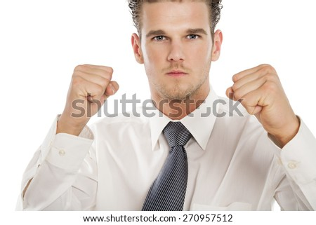 Confident young business man ready to fight showing boxing fists. - stock photo