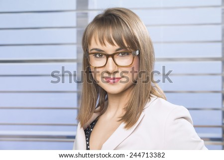 Confident young business woman in the office  - stock photo