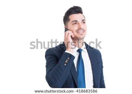 Confident young businessman calling on smartphone and smiling as successful business concept isolated on white - stock photo