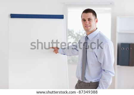Confident young businessman giving a presentation - stock photo