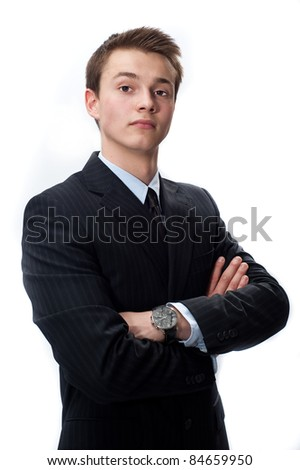 confident young businessman in a suit isolated on white - stock photo