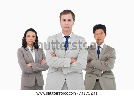 Confident young businessteam against a white background