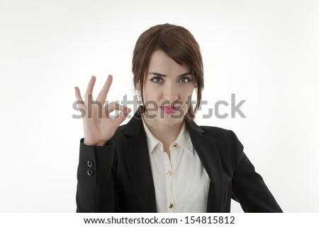 Confident young businesswoman showing OK sign  - stock photo