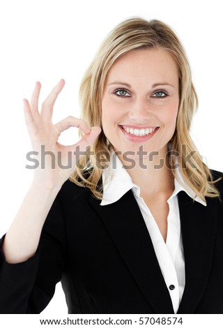 Confident young businesswoman showing OK sign against a white background - stock photo