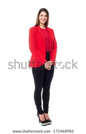 Confident young businesswoman wearing bright red blazer - stock photo