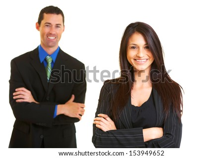 Confident young businesswoman with male colleague over white background