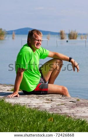 Confident young man on the shores of Lake Balaton - stock photo