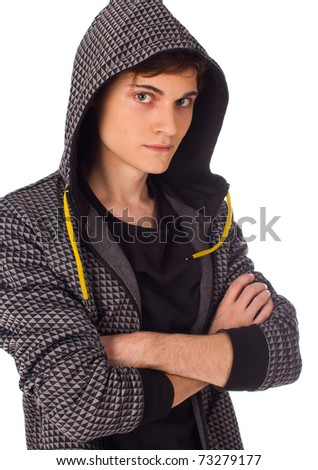 Confident young man seriously looking at camera - stock photo
