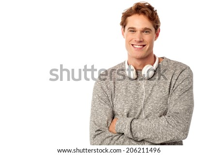 Confident young man with headphones around his neck - stock photo