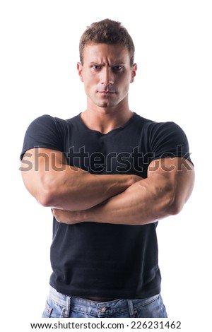Confident Young Muscled Man in Black Shirt Crossing Arms in Front of the Camera with Serious Face. Isolated on White Background. - stock photo