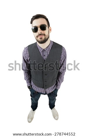 Confident young relaxed hipster with hands in pockets. High view wide angle lens portrait isolated over white background.  - stock photo