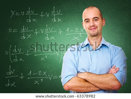 confident young teacher and classic chalkboard background - stock photo