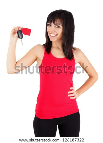 Confident young woman smiling happily with a new car key with tag in her hands - isolated on white. - stock photo