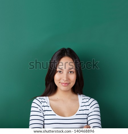 confident young woman with blackboard in background - stock photo