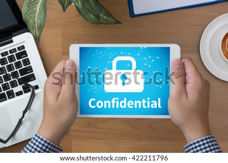 Confidential Concept        man hand Tablet and coffee cup - stock photo