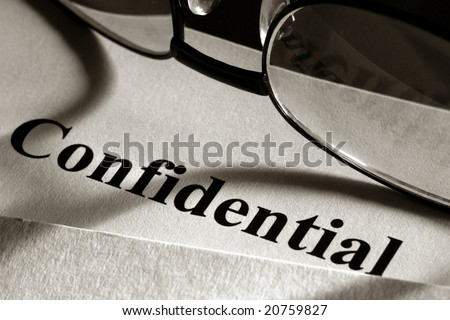 Confidential document in a secret file folder with glasses