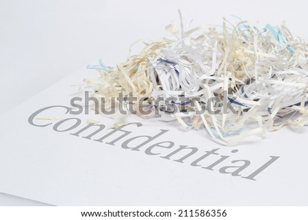 confidential document shredded  - stock photo
