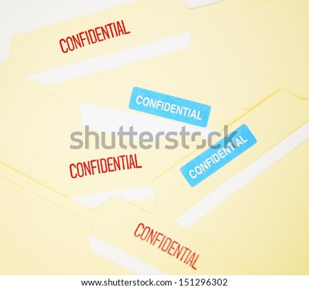 Confidential files.  Confidential files concept for proprietary business information, data privacy and security, legal settlement or breach.  - stock photo