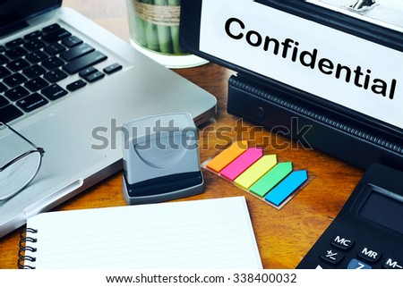 Confidential - Office Folder on Office Desktop with Office Supplies. Business Concept on Toned and Blurred Background - stock photo