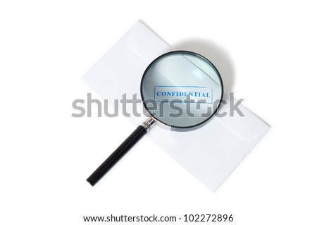confidential stamp on envelope with magnifying glass isolated on white background - stock photo