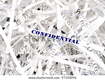 Confidential text surrounded by shredded paper. Great concept for information protection - stock photo