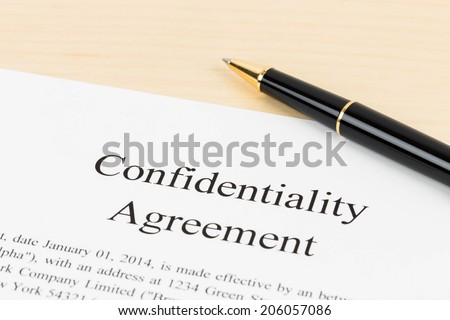 Confidentiality agreement document with pen close-up - stock photo