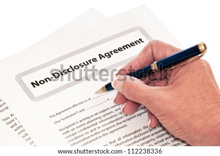 Confidentiality agreement for protection of company secrets. - stock photo