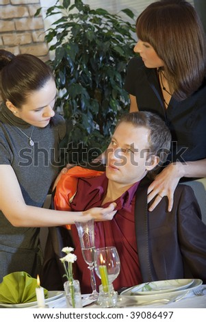 conflict between a lover and girlfriend in restaurant - stock photo