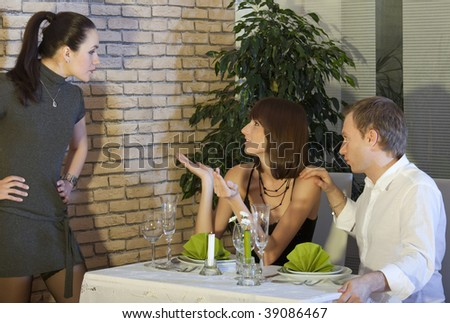 conflict between two women in restaurant - stock photo