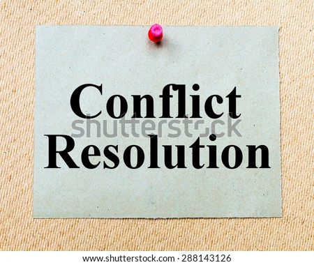 Conflict Resolution written on paper note pinned with red thumbtack on wooden board. Business conceptual Image - stock photo