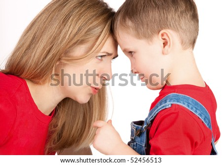 Conflict with mother and son - stock photo