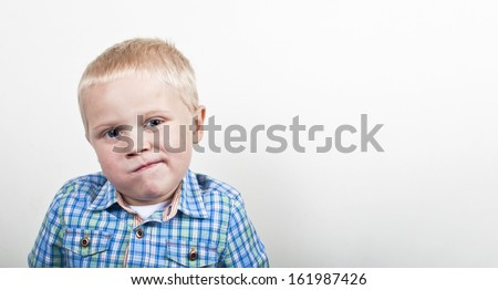 Confused boy - stock photo